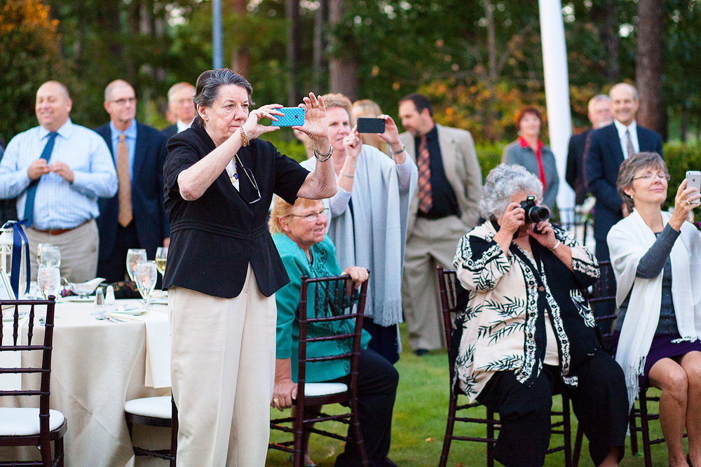 Guests Taking Pictures at a Wedding