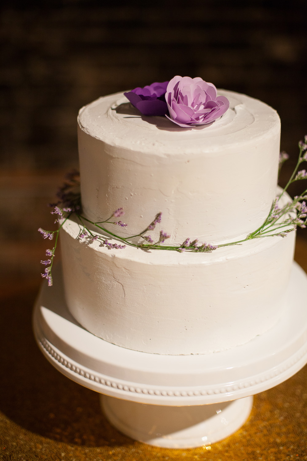 White Wedding Cakes with Paper Flowers on Top
