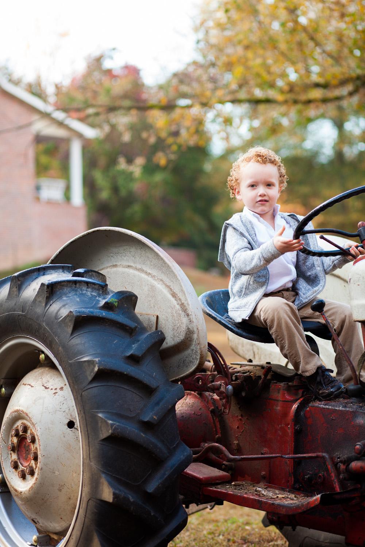 boys portrait on tractor in oxford georgia