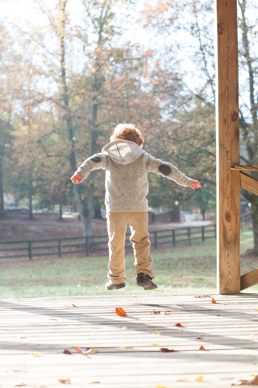 boy jumping from gazebo covington georgia
