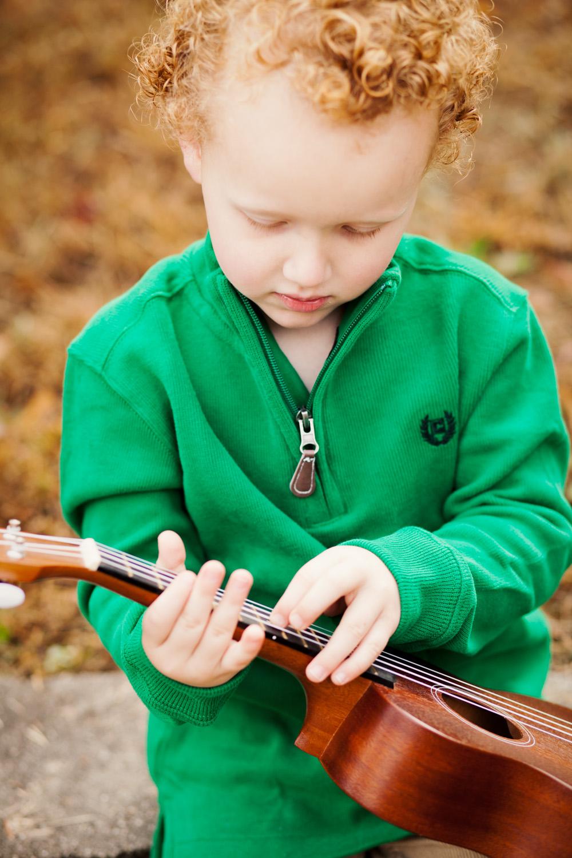 portrait of boy playing ukulele