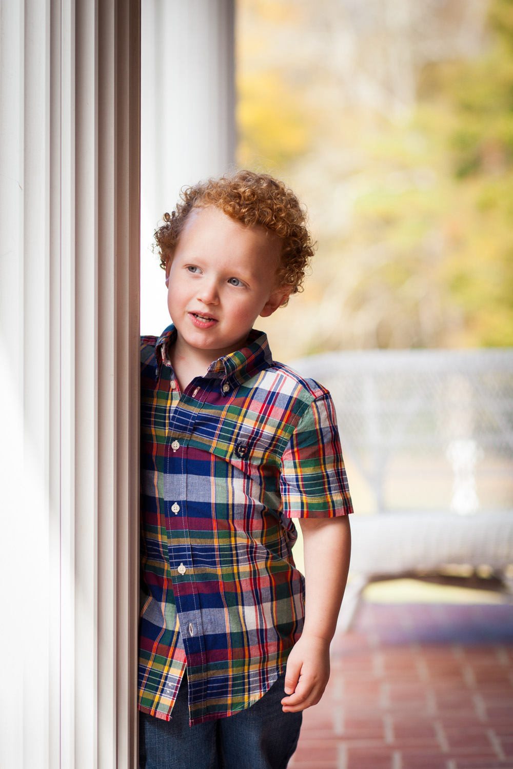 boy leaning against post oxford georgia home