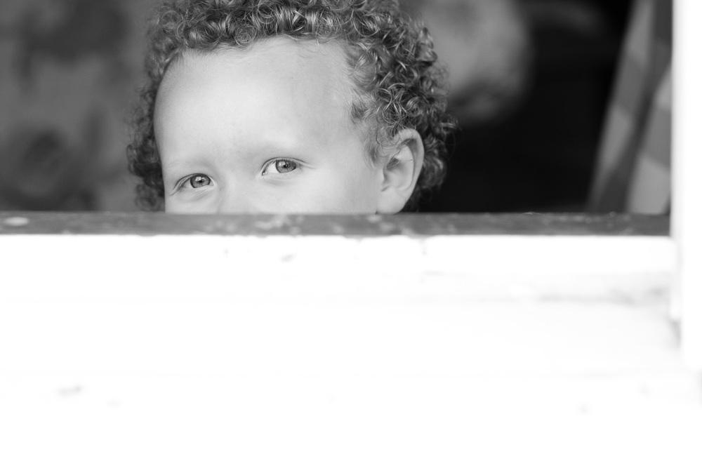 boy peeking in portrait