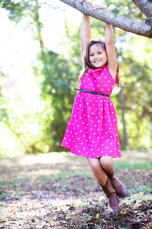girl swinging from tree portrait in covington