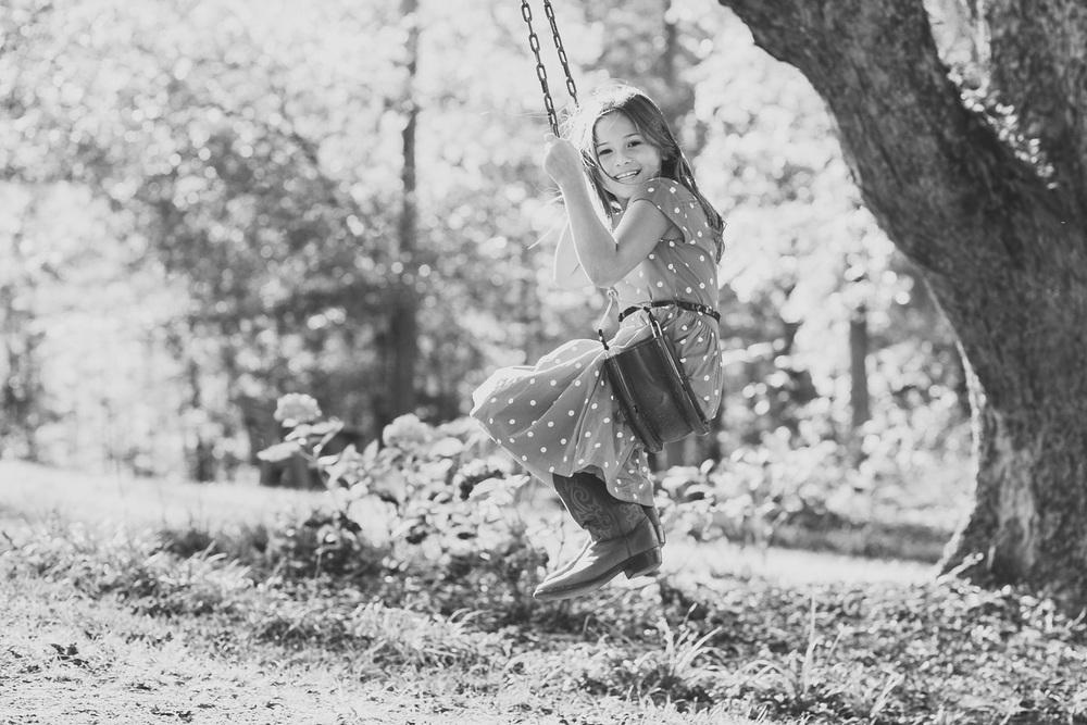 kids photography action shot swinging