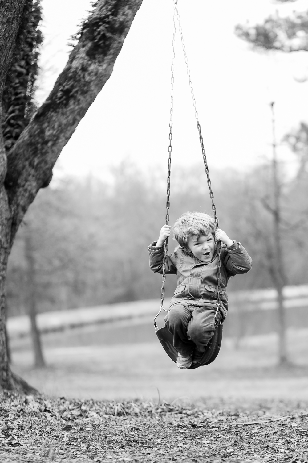 covington photographer kid swinging in oxford georgia