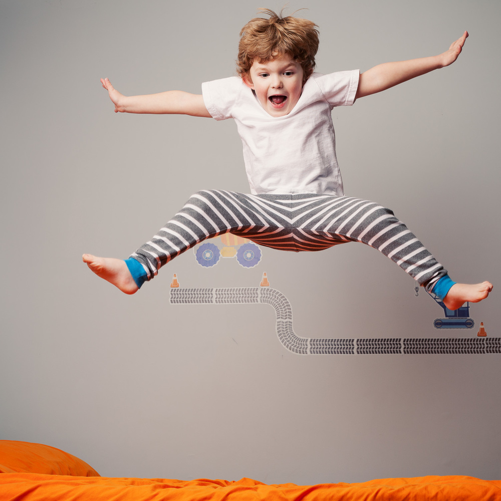 atlanta kids photographer jumping on the bed