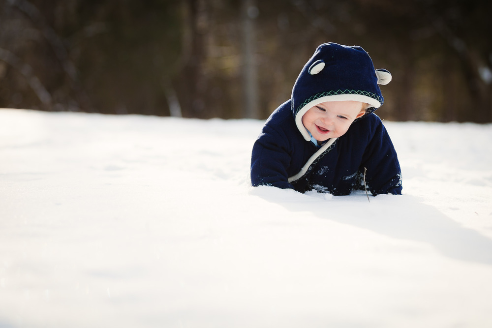 Atlanta kids photographer baby portrait crawling in snow