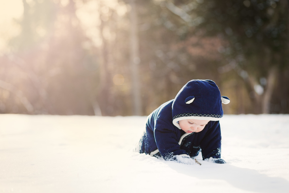Atlanta kids photographer beautiful backlit baby in snow