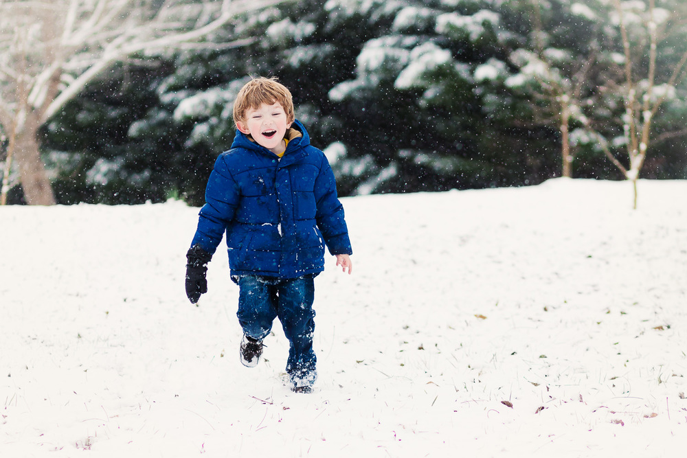 atlanta kids photographer boy running in the snow