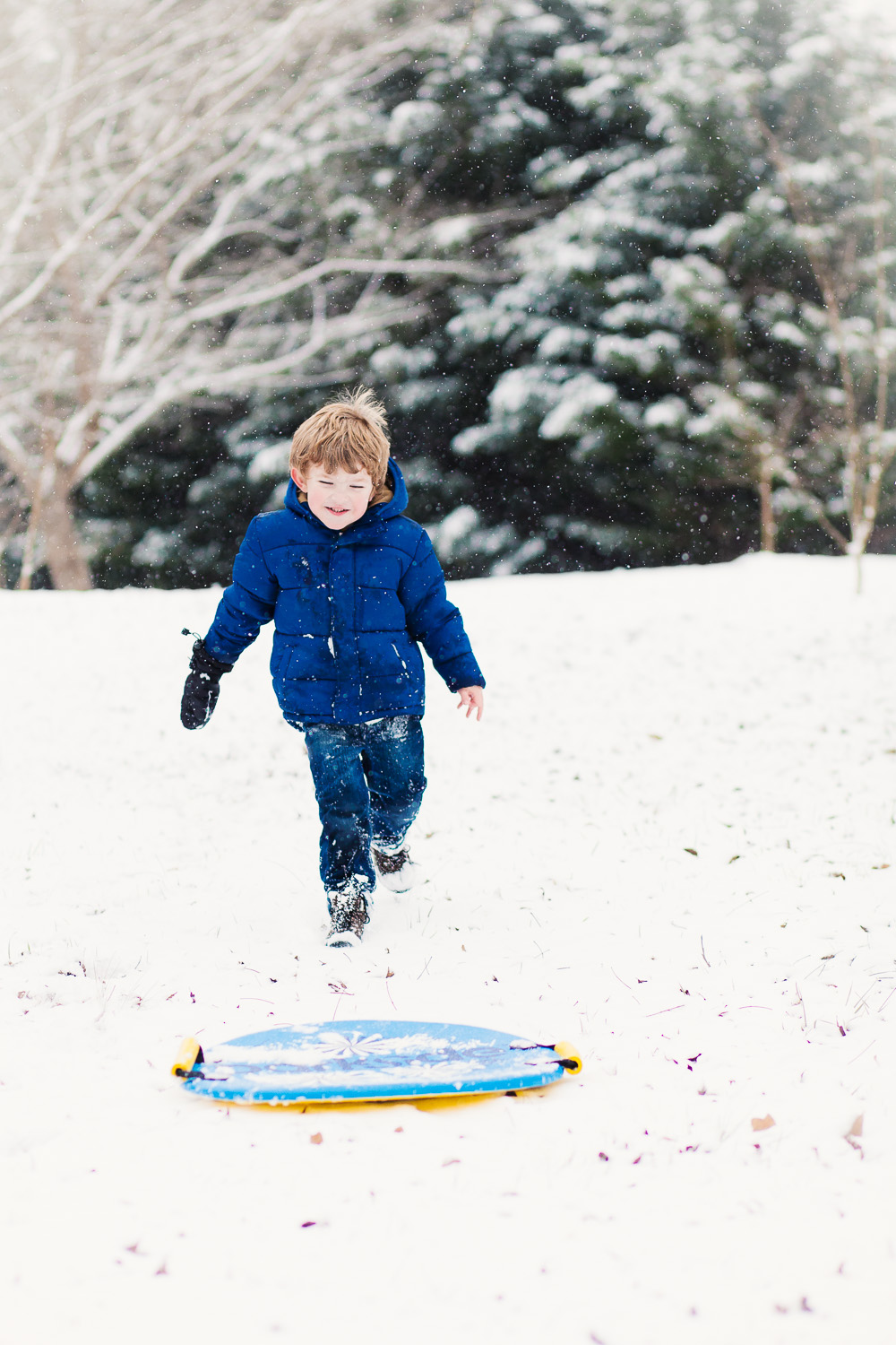 atlanta kids photographer boy running in snow