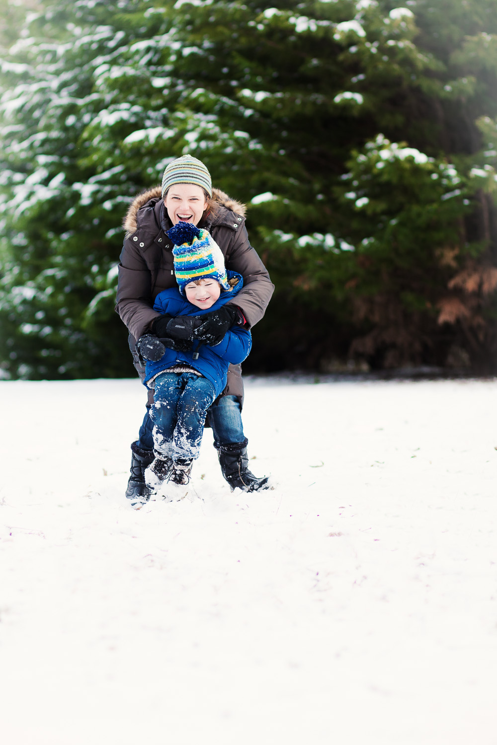 atlanta family photographer mom and son fun snow portrait