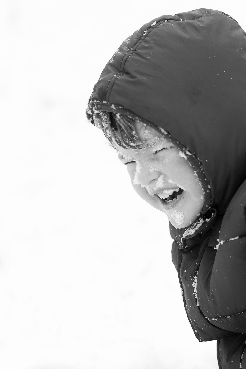 atlanta kids photographer boy face full of snow