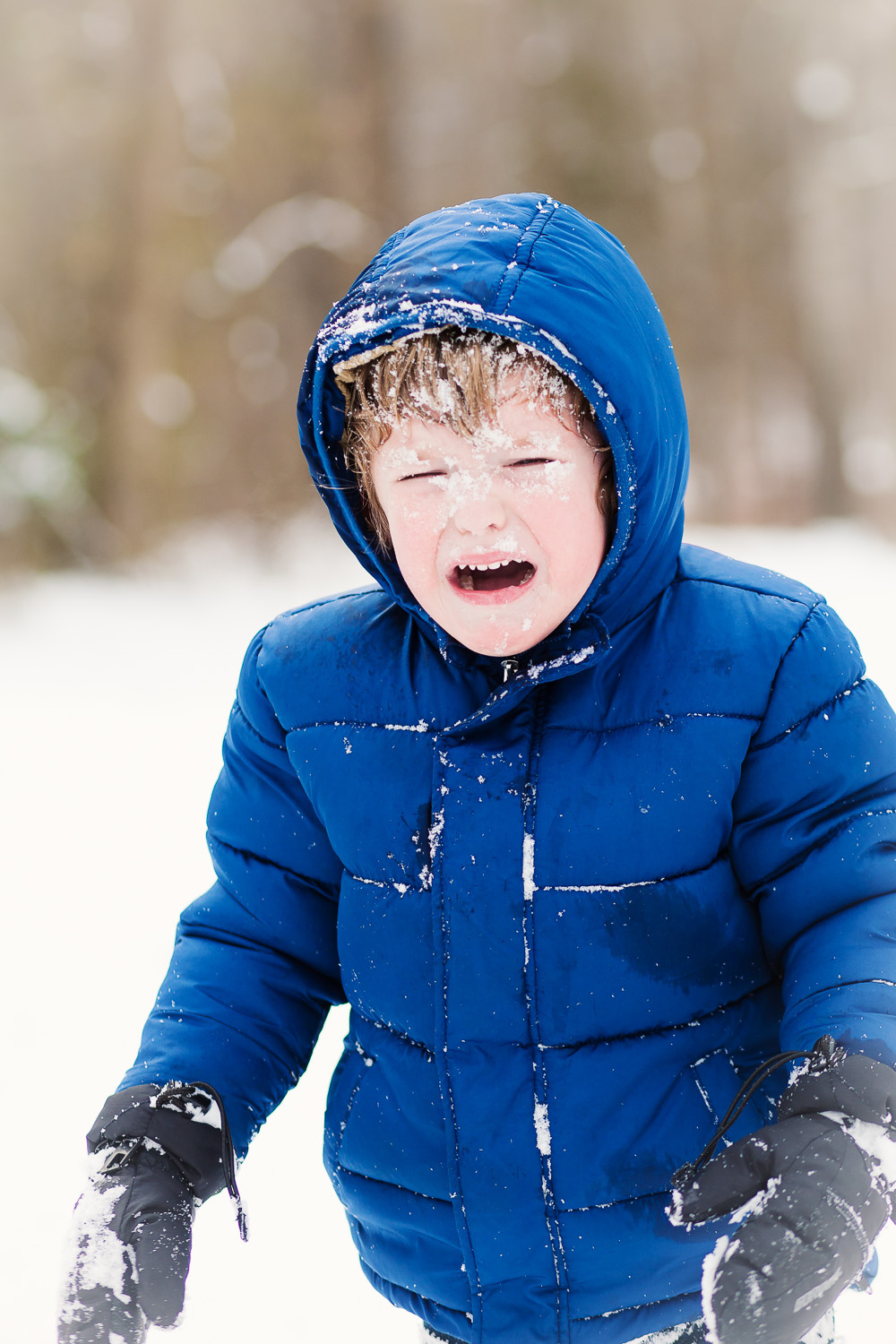 atlanta kids photographer real moments boy crying in snow