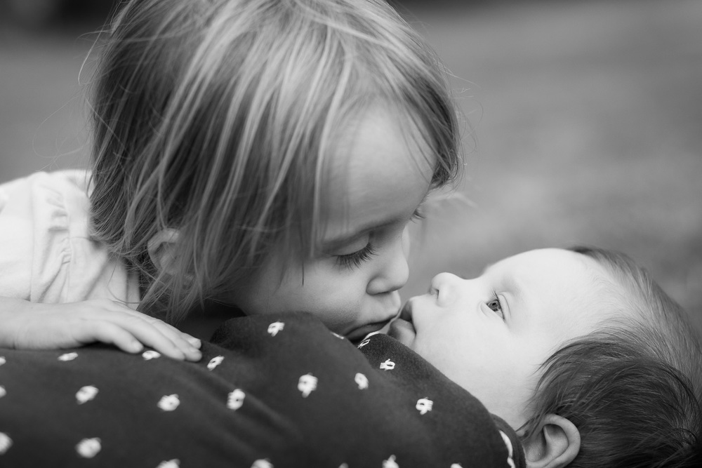 covington kids photographer brother and sister kissing