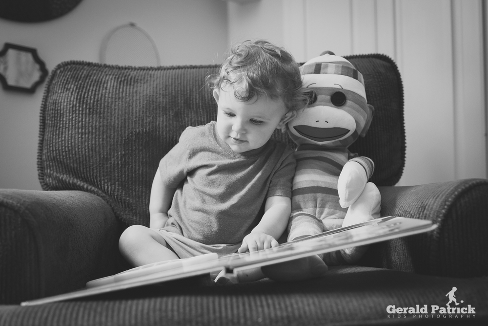 atlanta children's photographer boy reading to sock monkey