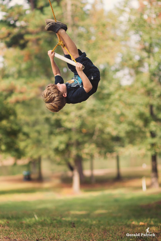 atlanta photographer boy playing on swing