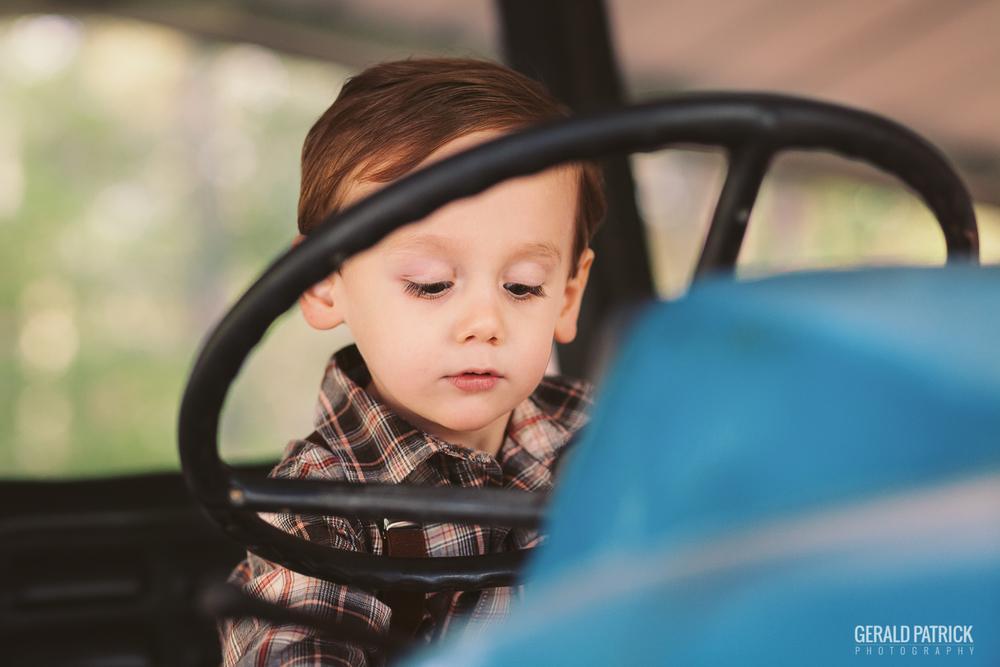 covington photographer boy riding on tractor