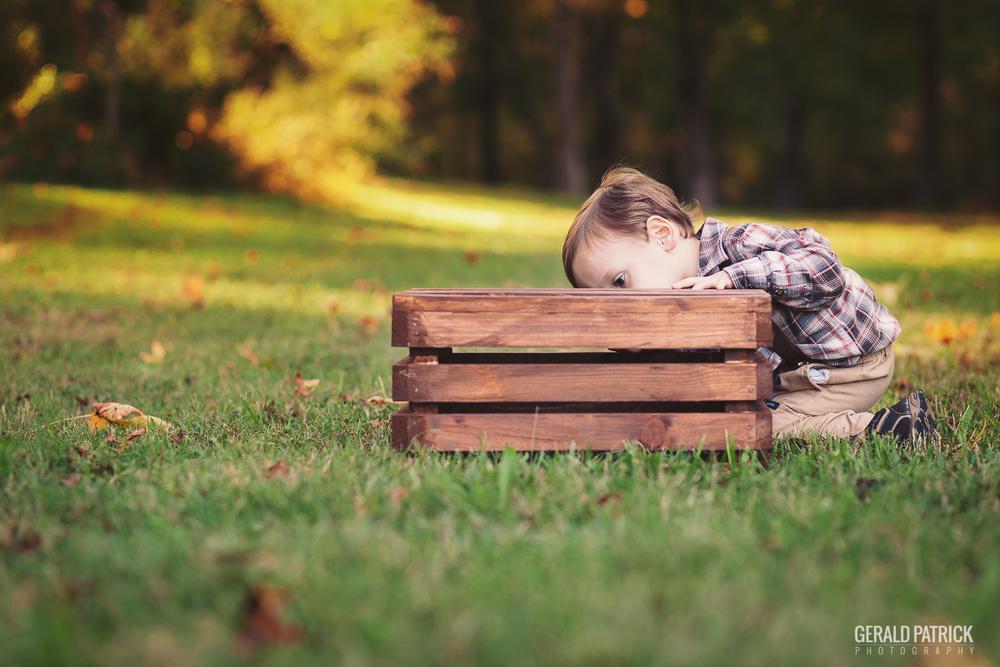 covington ga photographer boy playing with box