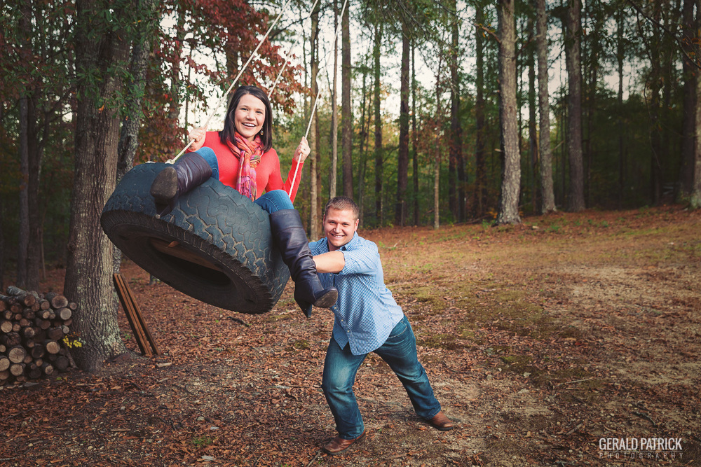 Covington GA photographer fun couple in tire swing