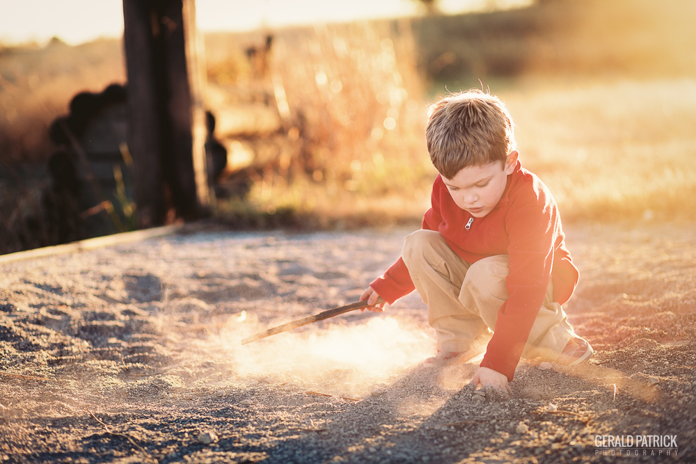 covington ga photographer boy playing in sand