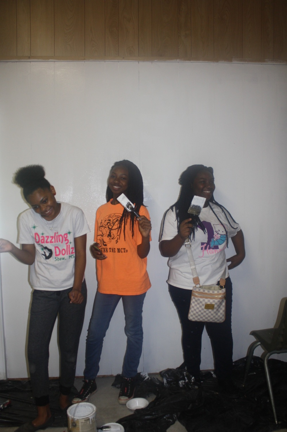 Tiyanna, Makayja, and Tamyra pose while painting