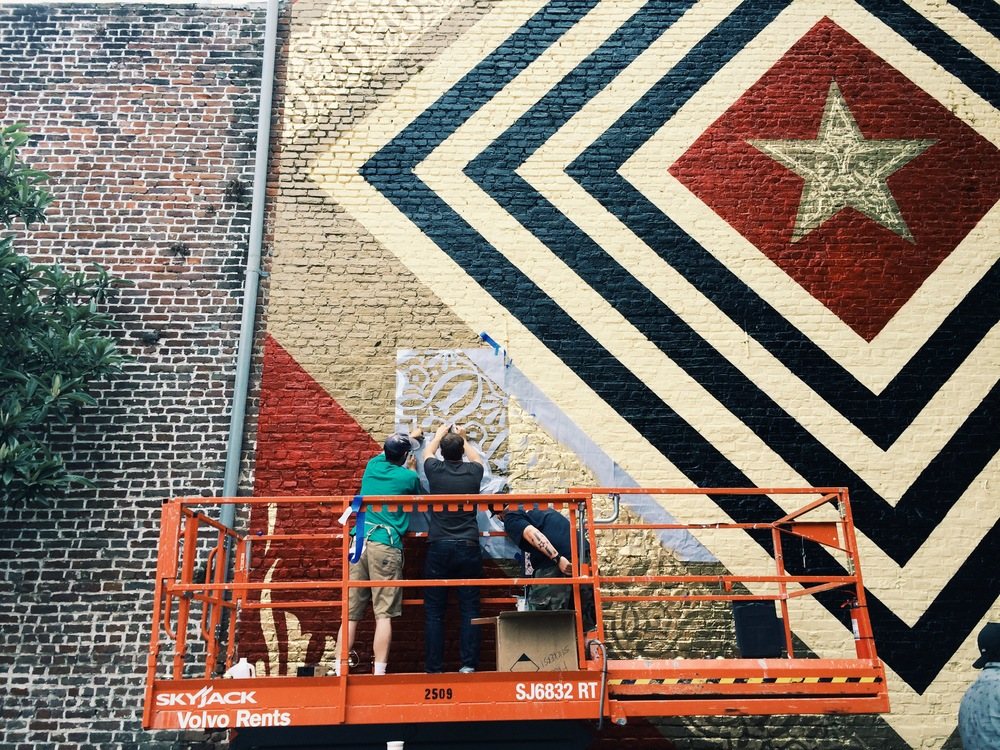 Shepard Fairey stenciling in detail on King Street