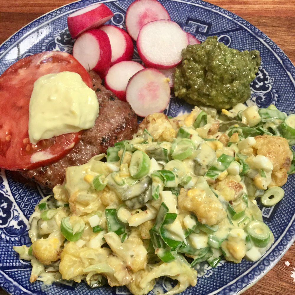 Here's a lunch we had recently, Cauliflower Tater Salad was really the main dish served with a pork/beef burger, with a tomato slice and a dollop of mayo and some butter Pesto as a dip for the radishes.