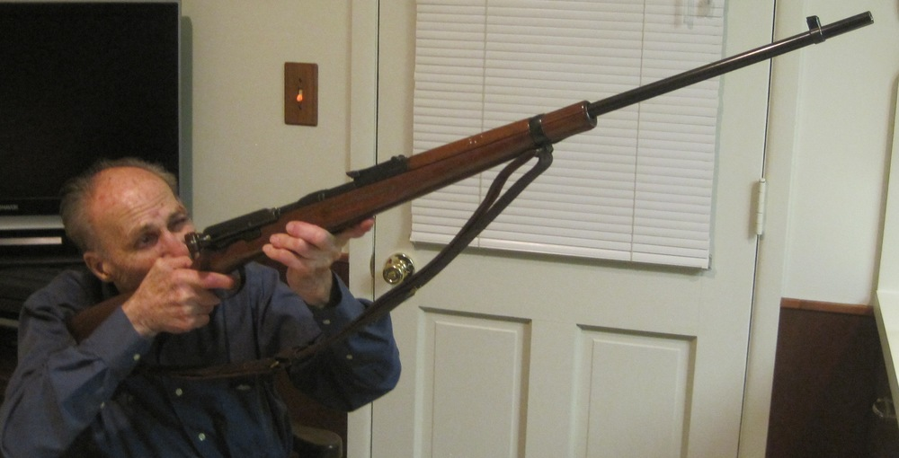 My dad with the same rifle 35 years later