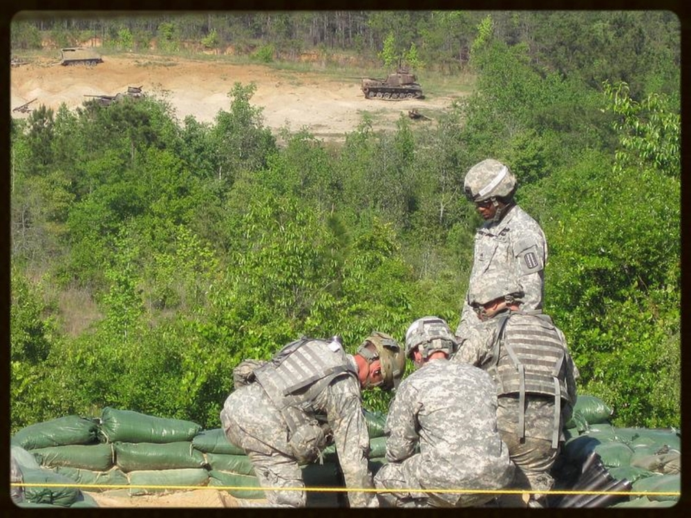 Friday, April 13, 2012.   Rangers firing high explosive shells from handheld 60mm M224 mortars. Best Ranger Competition, Fort Benning, Georgia.