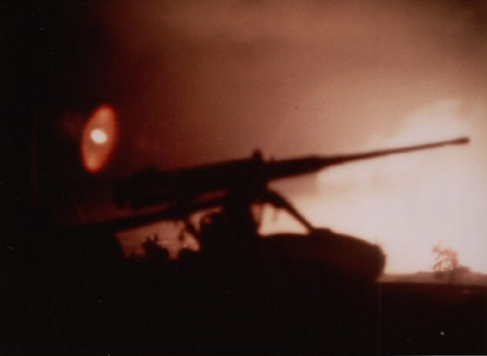 Early morning hours, Wednesday, January 31, and the Tet Offensive has just been launched. View is from atop LZ Betty's water tower