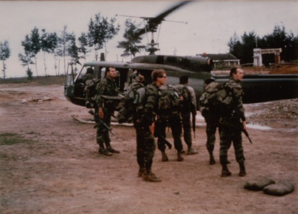 Boarding a Huey for a patrol (Cpls Forrest Decker and Burt Penkunis in foreground)