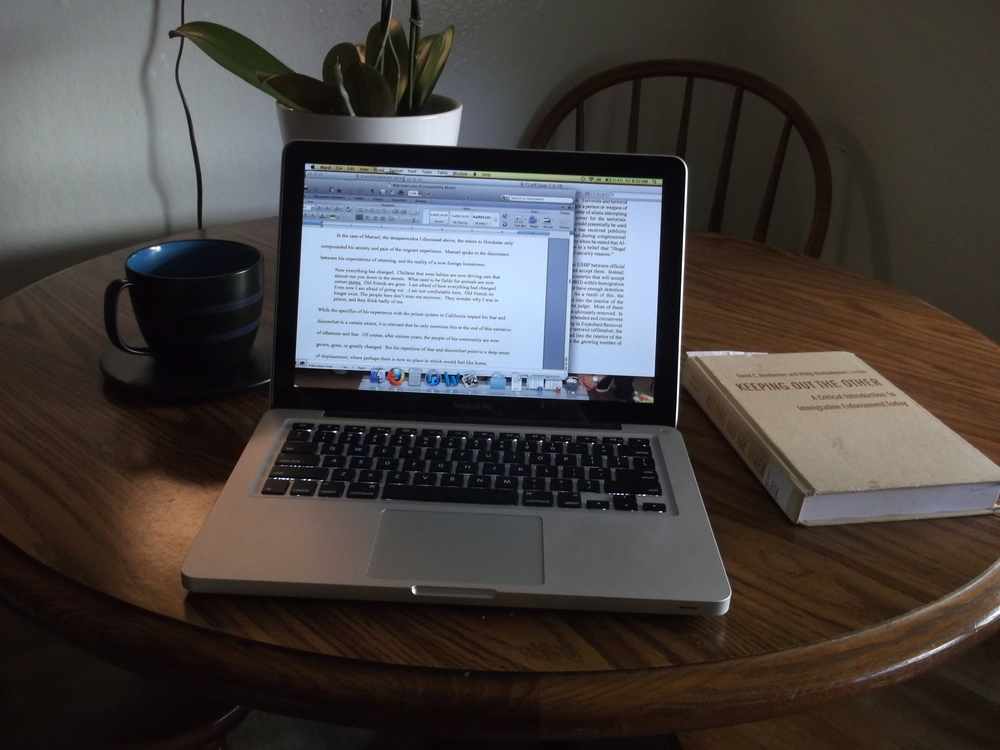 "This is a picture of working on my thesis at a friend's house. The desired illustration being ""do your research."""