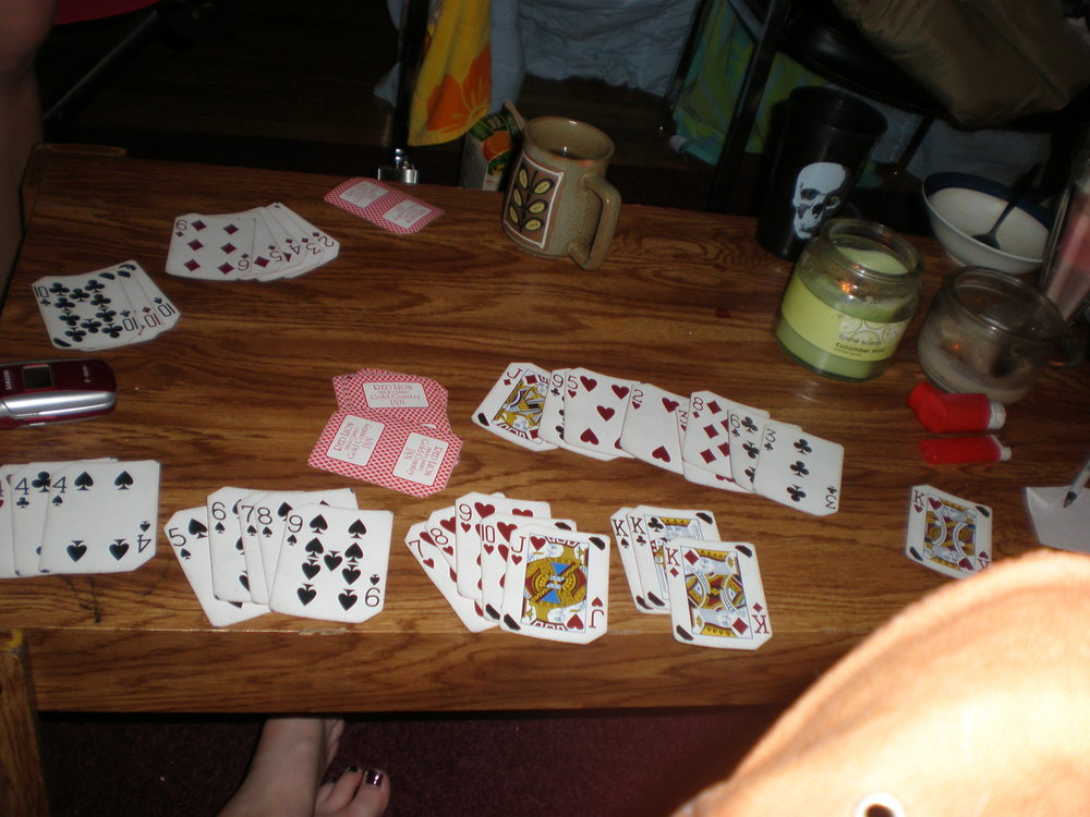 Cards at the end of a dramatic hand of gin. This particular game was played with college friends, but the resulting card skills were used to great effect with family.