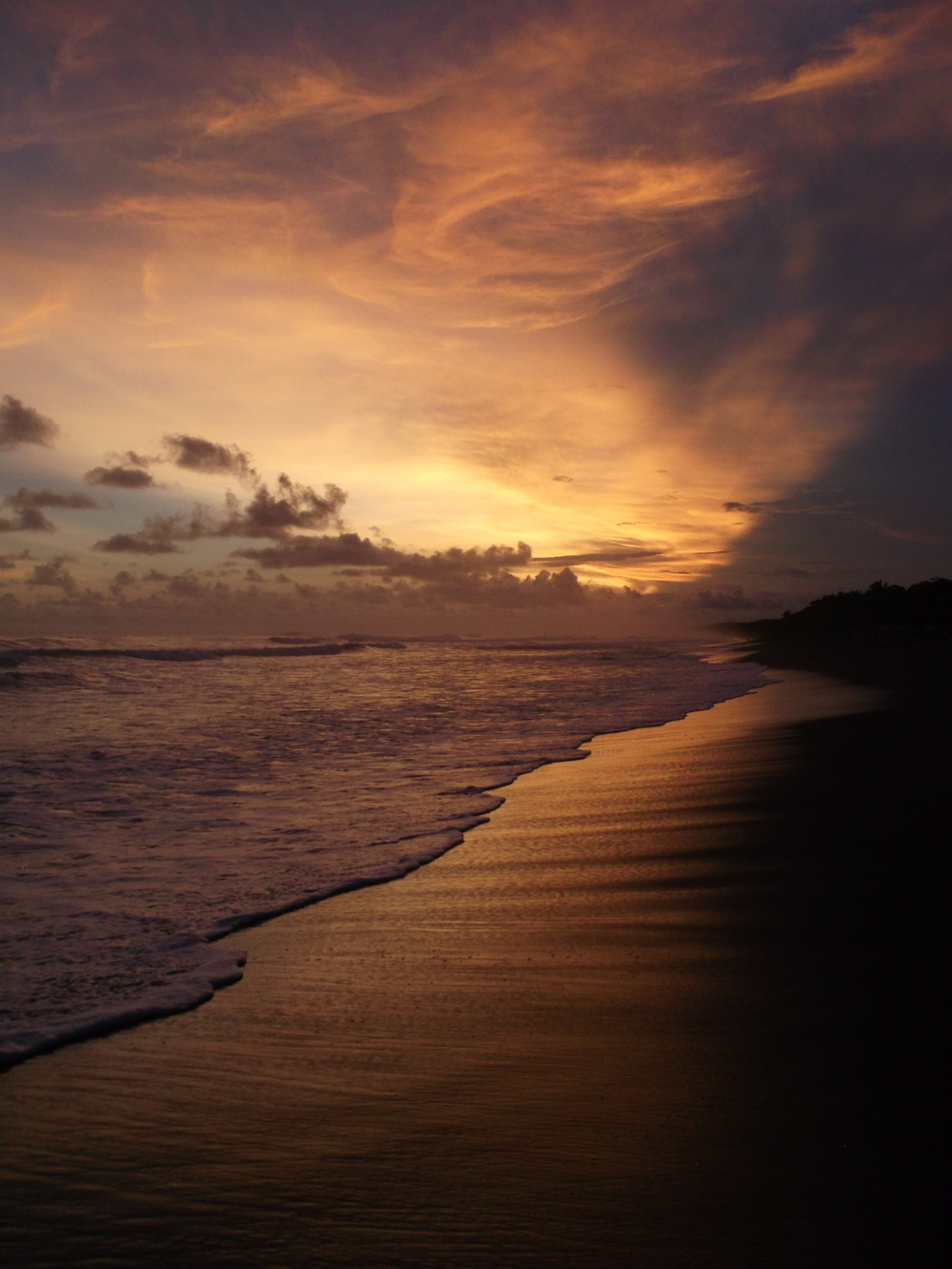 Studying abroad could lead you here (sunset on a beach in Costa Rica). Worth a little extra work? I think so.