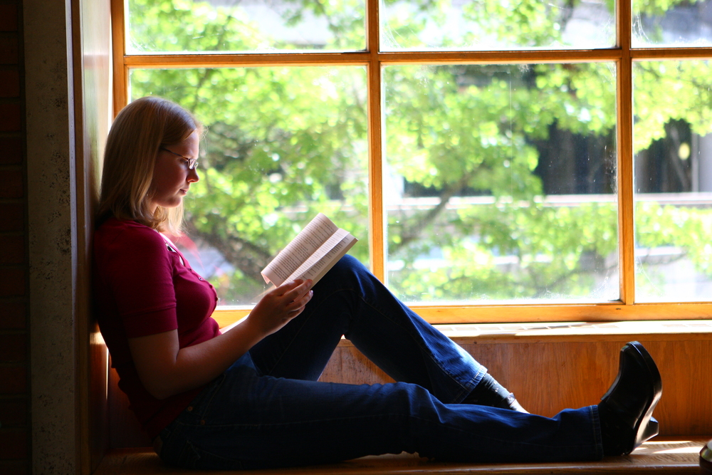 Yep, that's me reading in a gigantic window. Paradise.