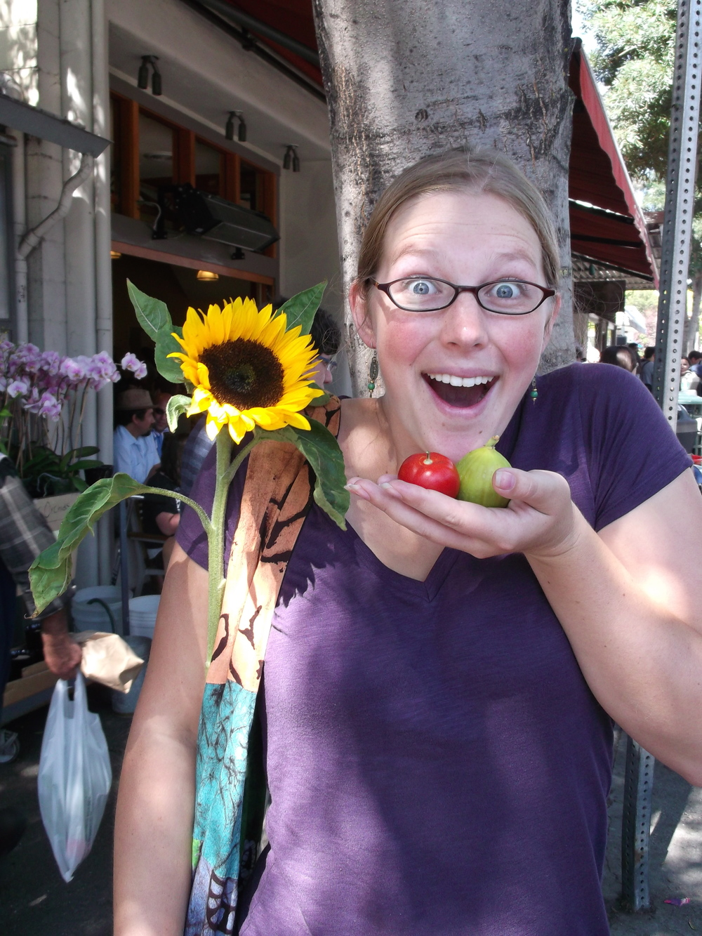 Advice for being a houseguest: bring a gift. (In this case, a sunflower, tomato, and fig from the Berkeley farmer's market. Also the goofiest face possible.)