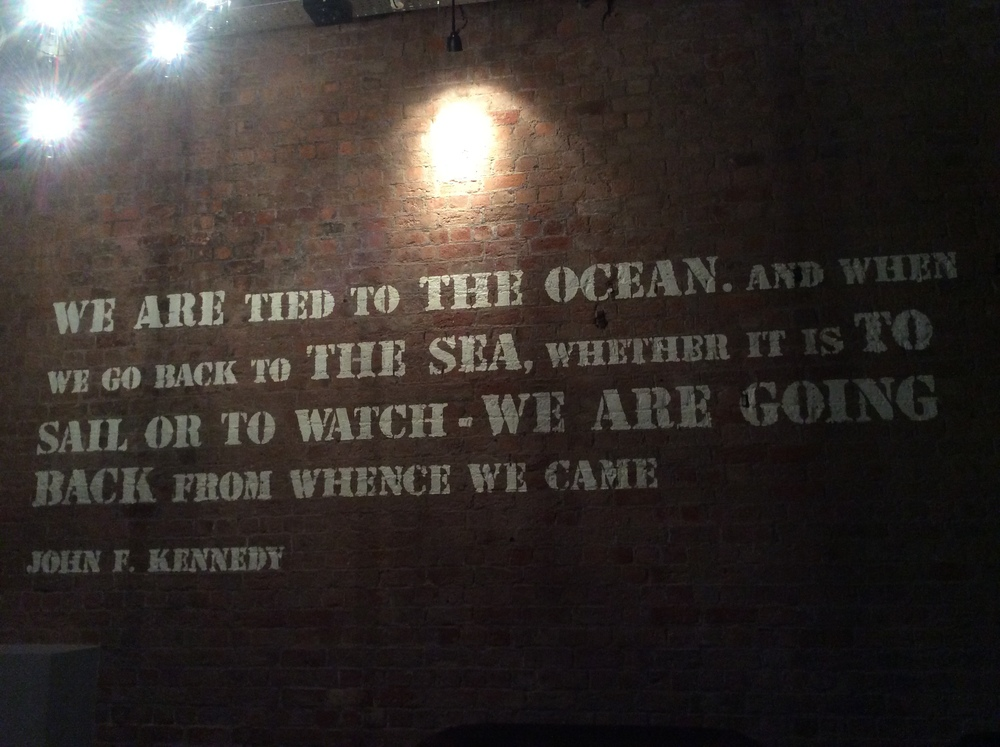 """This quote is on the wall of the hotel where I am staying for one night before shipping out. """"We are tied to the ocean, and when we go back to the sea, whether it is to sail or to watch0we are going back from whence we came."""" John F. Kennedy"""