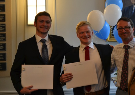 John (left) and Michael (center) accept the Vincent Manno Leadership Award from Department Chair Bill Messner (right).