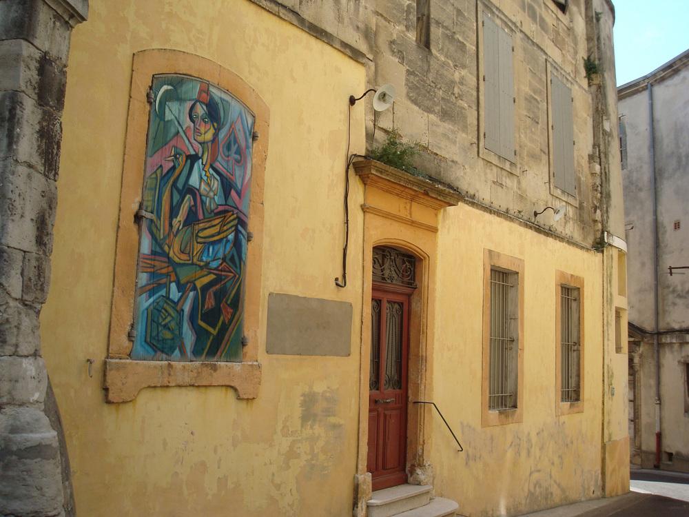 DominantSuit-Arles-yellow-house-wall.jpg