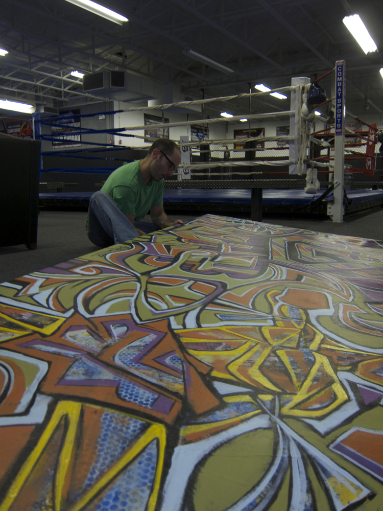 Stretching the roll of canvas on site