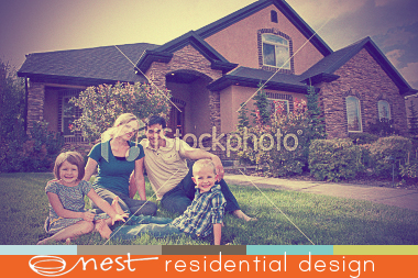 family-of-four-on-lawn-with-beautiful-home-in-background.jpg