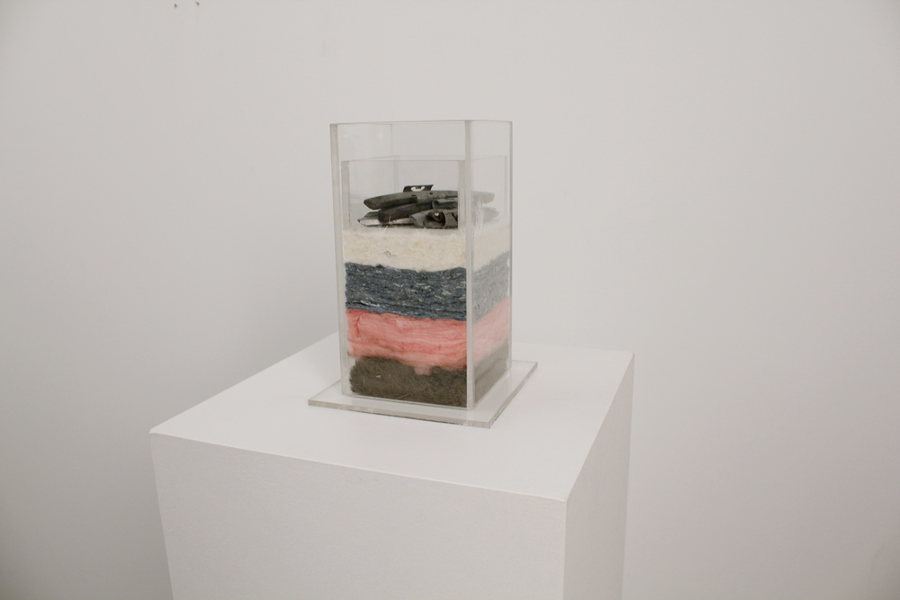 On the Open Road. Rock wool, fiberglass, and deniminsulation, goose down, lead wheel weights, acrylic. 2015. 9x6x6in.