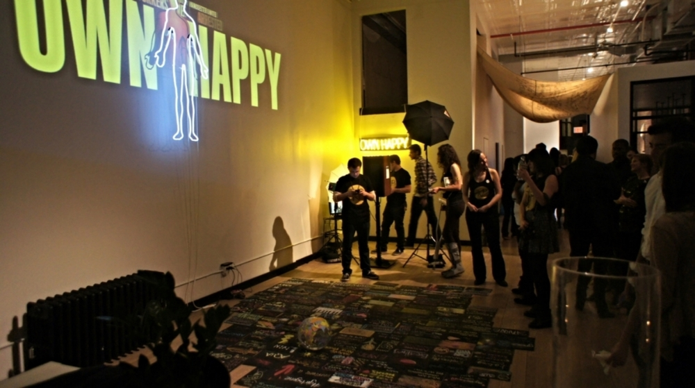 OWN HAPPY    OWNING HAPPY FROM THE INSIDE OUT   An interactive experience invites viewers to reflect on their unique definition of happiness.  A life-sized light installation illustrates the physicality of emotions and illustrates that happiness is the only emotion felt through the entire body. Using this discovery as backdrop, guests engage in activities that turn participants into artists and strangers into friends.     HOST: AQUA Studio NY in NYC