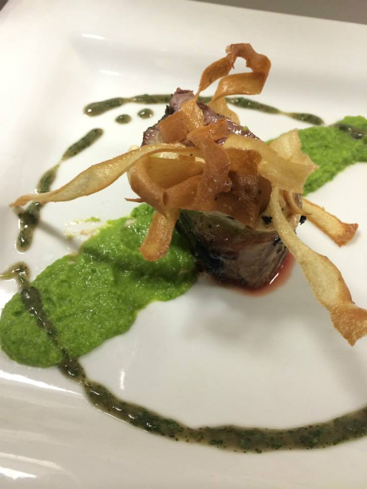 Herb Rubbed Lamb Loin, Foie Gras Butter, Green Pea Puree, Charred Mint Vinaigrette, and Crispy Parsnips