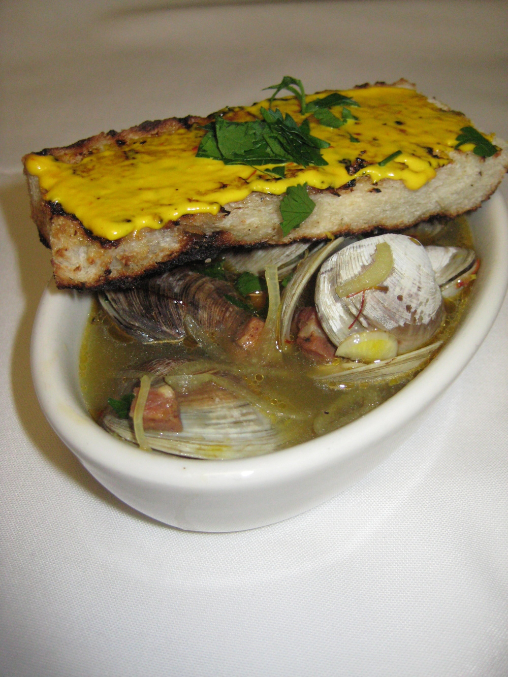 First Course: Littleneck Clams with Beer and Saffron Broth, Crusty Bread, and Garlic Saffron Aioli