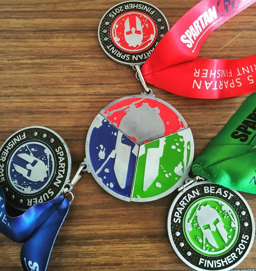 Spartan Trifecta Medals 2015.jpg