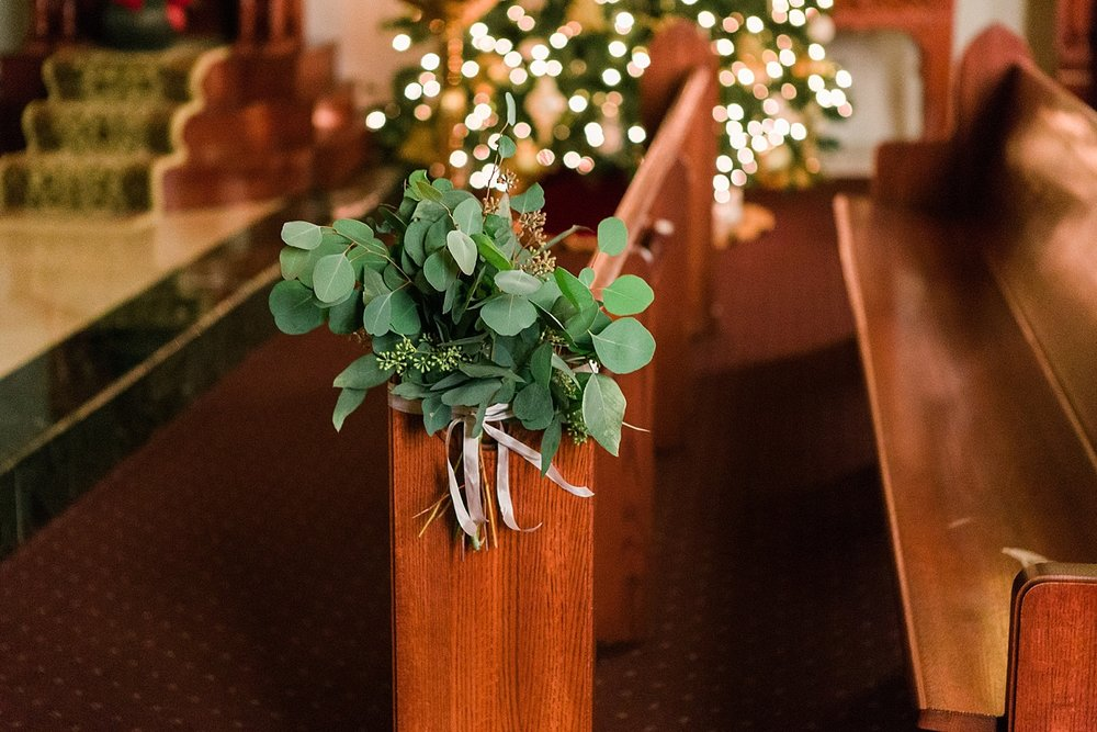 A bundle of seeded eucalyptus tied to church pews (photo by Katie Ricard)