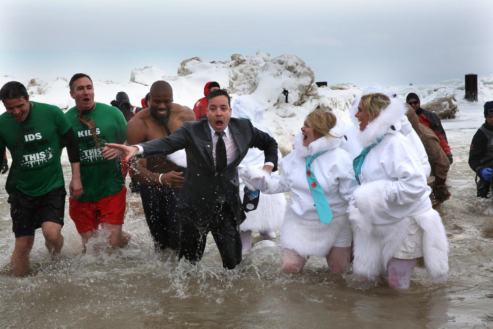 Jimmy Fallon emerges from the water after taking the Polar Plunge. (Nancy Stone / Chicago Tribune)