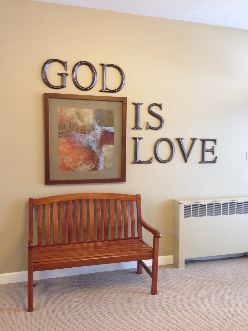 """God is Love"" foyer quote on wall."